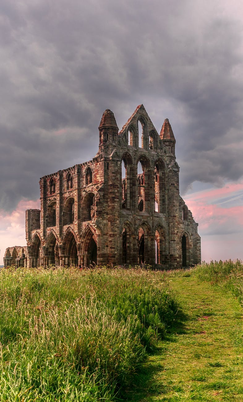photo of old church building under cloudy sky